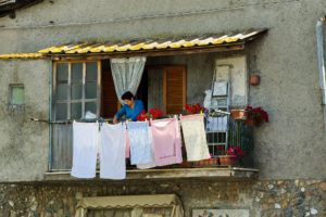 woman hanging laundry is evaluated using the most used ADL assessment